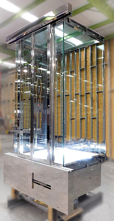 Full glass elevator cab manufactured in Roys Rise's factory